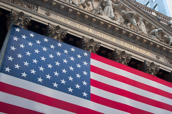 An American flag hangs on the front of the New York Stock Exchange building